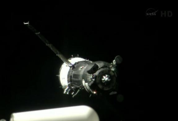 A Soyuz spacecraft carrying the Expedition 36/37 crew to the International Space Station is seen in station cameras just before docking on May 28, 2013.