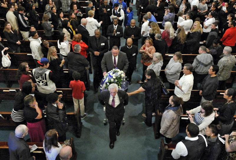The casket is brought down the aisle for the recessional during the funeral service for 5-year-old Jeremiah Oliver at Rollstone Congregational Church in Fitchburg, Mass., on Saturday, May 3, 2014. Jeremiah Oliver is the 5-year-old Fitchburg boy who disappeared in September 2013 and was found dead along Interstate 190 in Sterling, Mass., in April. (AP Photo/Worcester Telegram & Gazette, Paul Kapteyn)