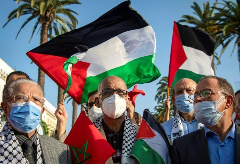 Moroccans wave the Palestinian flag during a demonstration in the capital Rabat in September 2020 to denounce Arabs' normalization with the Jewish state -- a step now taken by Morocco