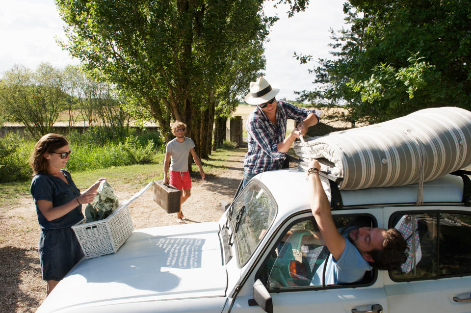Family tying mattress to roof. Source: Getty Images