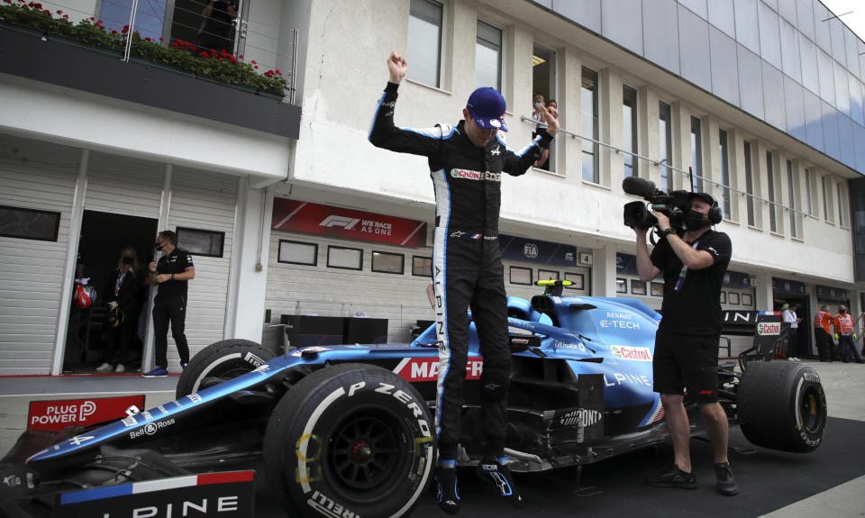 Alpine driver Esteban Ocon of France celebrates with his team after winning the Hungarian Formula One Grand Prix at the Hungaroring racetrack in Mogyorod, Hungary, Sunday, Aug. 1, 2021. (Florion Goga/Pool via AP)