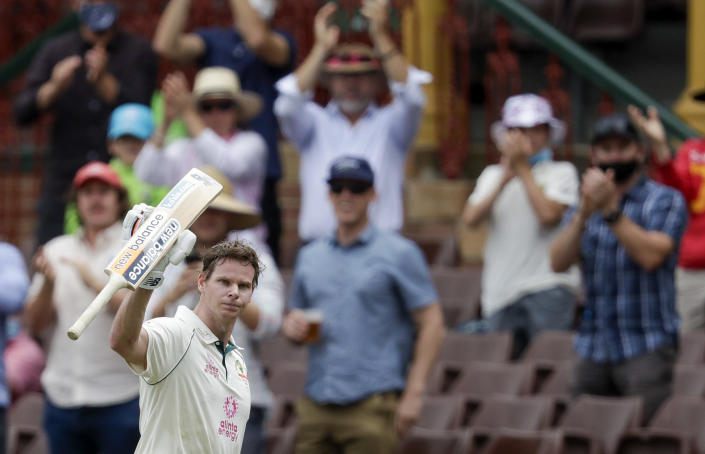 Australia's Steve Smith waves to the crowd as he walks from the field after he was run out 131 runs during play on day two of the third cricket test between India and Australia at the Sydney Cricket Ground, Sydney, Australia, Friday, Jan. 8, 2021. (AP Photo/Rick Rycroft)