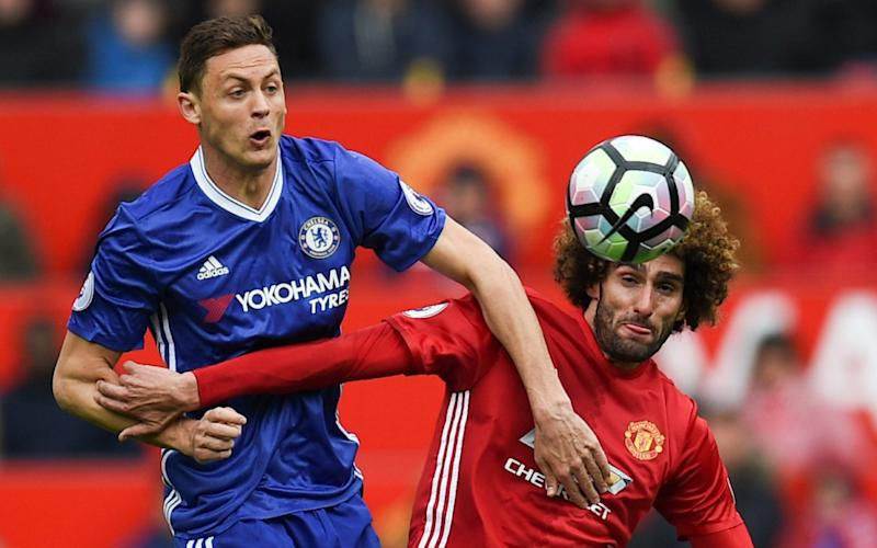 Nemanja Matic and Marouane Fellaini - Credit: OLI SCARFF/AFP/Getty Images