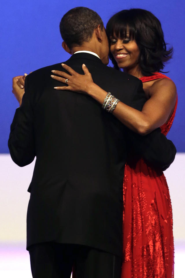President Barack Obama and first lady Michelle Obama dance together at the Commander-in-Chief Inaugural Ball in Washington, at the Washington Convention Center during the 57th Presidential Inauguration Monday, Jan. 21, 2013. (AP Photo/Jacquelyn Martin)