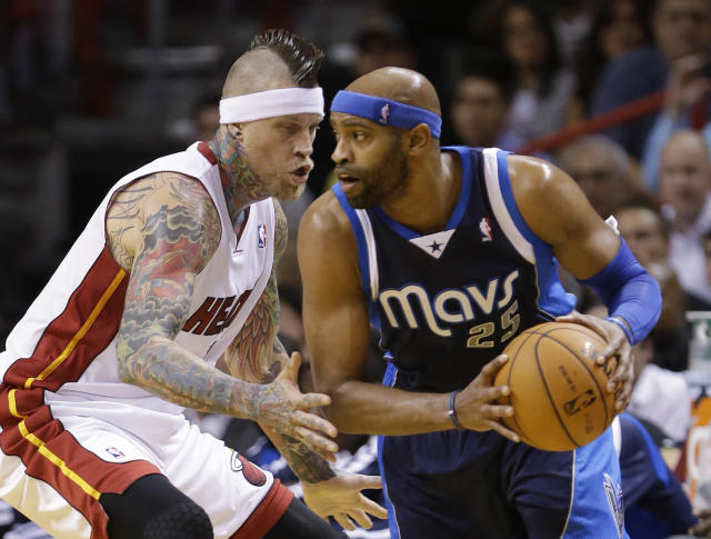 Dallas Mavericks guard Vince Carter (25) looks for an opening past Miami Heat forward Chris Andersen during the first half of an NBA basketball game Friday, Nov. 15, 2013, in Miami. (AP Photo/Wilfredo Lee)