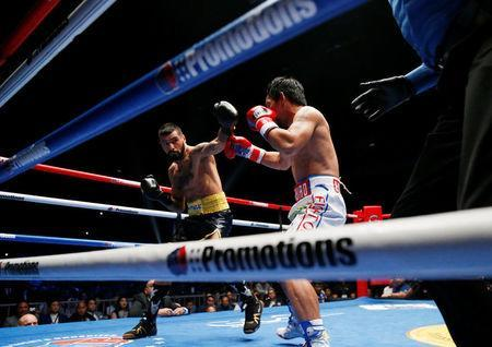 Boxing - WBA Welterweight Title Fight - Manny Pacquiao v Lucas Matthysse - Axiata Arena, Kuala Lumpur, Malaysia - July 15, 2018 Manny Pacquiao in action against Lucas Matthysse REUTERS/Lai Seng Sin