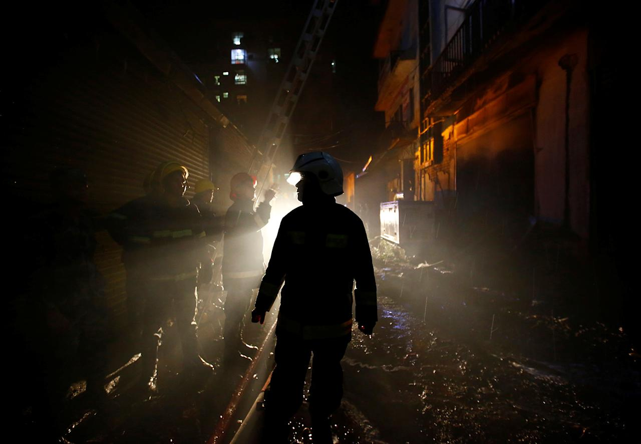 <p>Firefighters work to extinguish a fire at a warehouse in Kathmandu, Nepal, April 30, 2017. (Photo: Navesh Chitrakar/Reuters) </p>