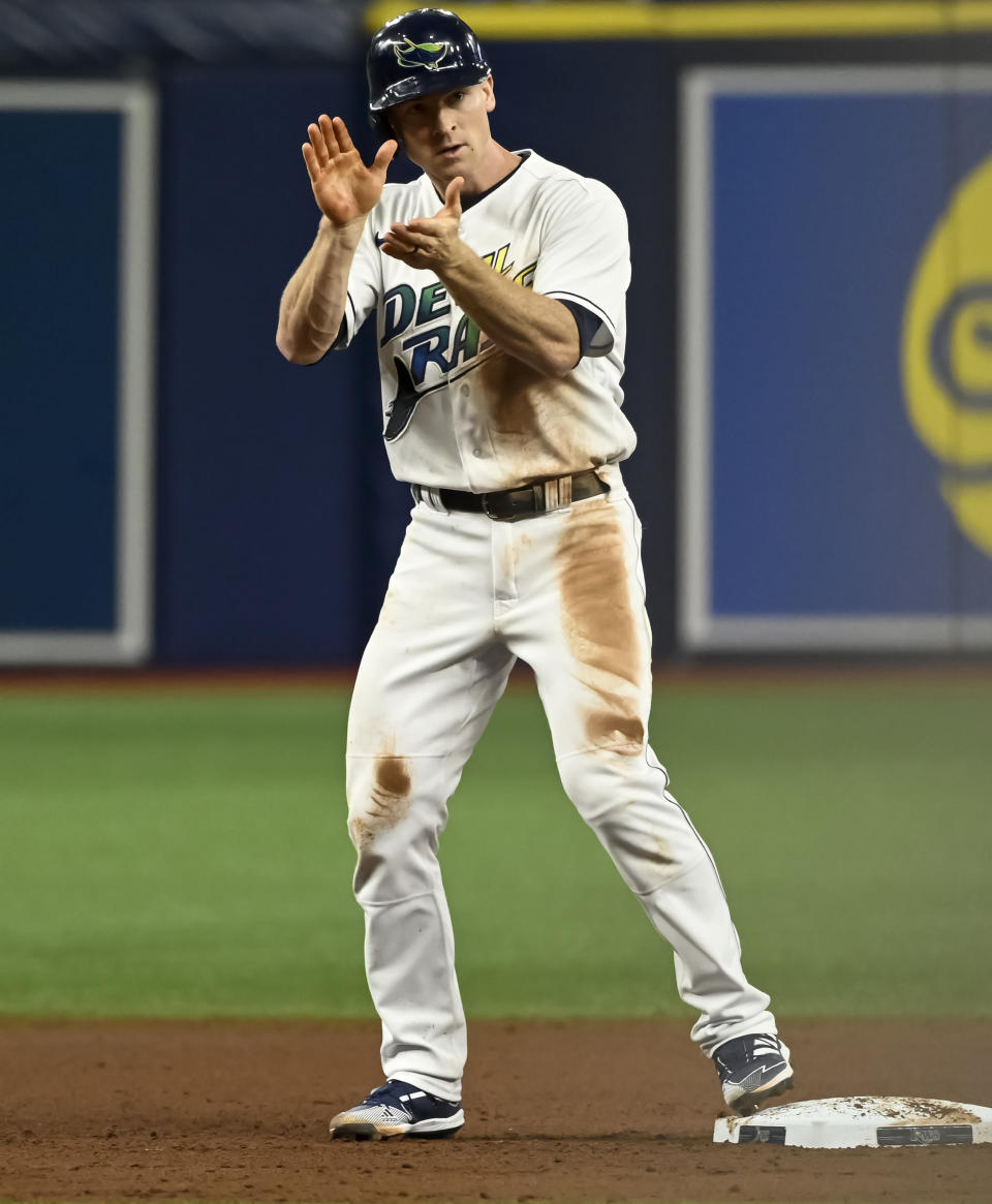 Tampa Bay Rays' Joey Wendle claps from second base after hitting an RBI-double off Miami Marlins' Sandy Alcantara during the fourth inning of a baseball game Saturday, Sept. 25, 2021, in St. Petersburg, Fla. (AP Photo/Steve Nesius)