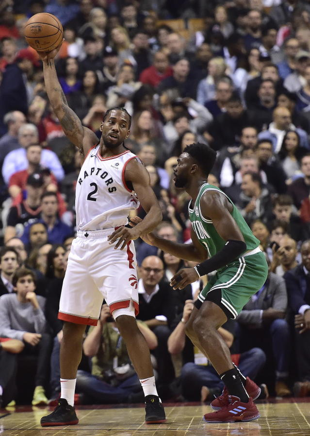 Toronto Raptors forward Kawhi Leonard (2) controls the ball as Boston Celtics forward Jaylen Brown (7) applies pressure during first-half NBA basketball game action in Toronto, Friday, Oct. 19, 2018. (Frank Gunn/The Canadian Press via AP)