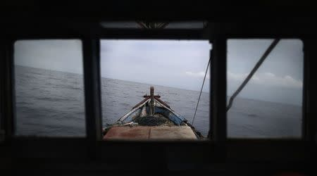 The boat of local fisherman Rusli Suhardi heads towards fishing grounds off the east coast of Natuna Besar July 9, 2014. REUTERS/Tim Wimborne