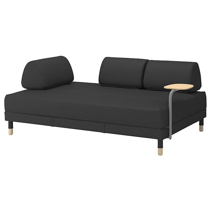 """If you have a love-hate relationship with IKEA, hear us out: The Flottebo is like a work of art with its movable back cushions. Plus, converting the sofa into a bed takes all of 10 seconds. No need to worry; this is definitely not one of the IKEA pieces that will take you a month to put together. $629, IKEA. <a href=""""https://www.ikea.com/us/en/p/flottebo-sleeper-sofa-with-side-table-vissle-dark-gray-s99297436/"""" rel=""""nofollow noopener"""" target=""""_blank"""" data-ylk=""""slk:Get it now!"""" class=""""link rapid-noclick-resp"""">Get it now!</a>"""