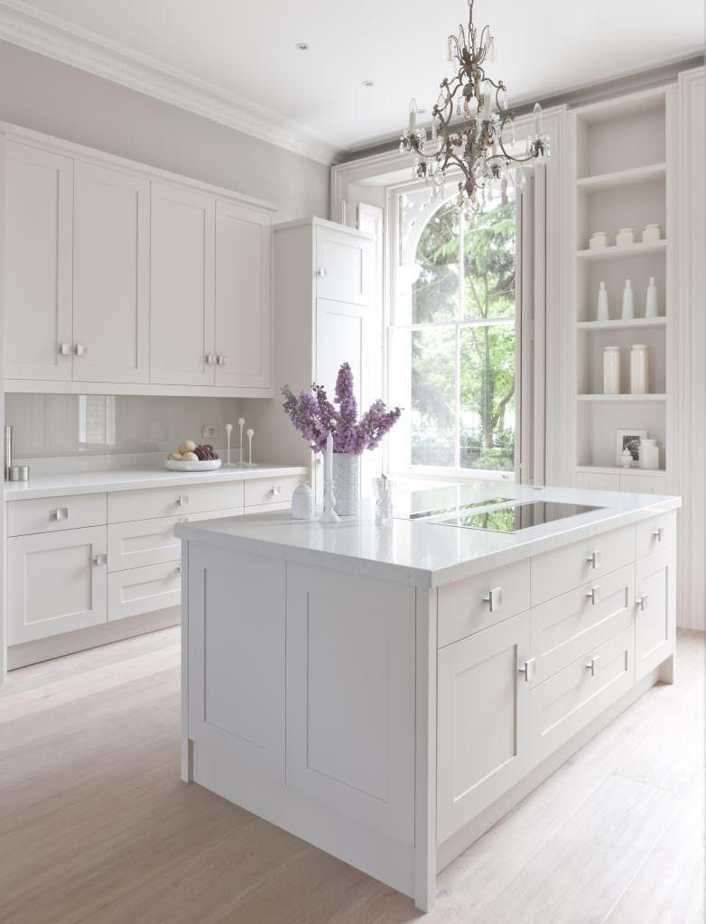 """<p>Shaker style cabinetry, with unexpected silver rather than the classic gold or brass hardware, a smattering of pure white accessories, and a feature chandelier is all that is needed to create a quietly opulent white kitchen. </p><p>Pictured: <a href=""""https://mowlemandco.com/?project=grace"""" rel=""""nofollow noopener"""" target=""""_blank"""" data-ylk=""""slk:Grace Kitchen at Mowlem & Co"""" class=""""link rapid-noclick-resp"""">Grace Kitchen at Mowlem & Co</a></p>"""