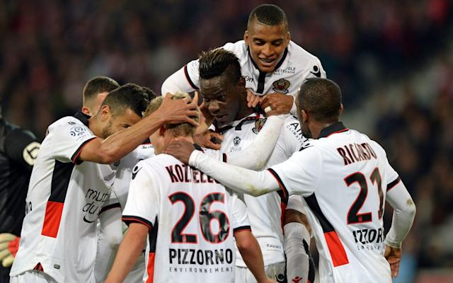 <span>Balotelli popular with his team-mates after scoring against Lille this weekend</span> <span>Credit: DENIS CHARLET/AFP </span>