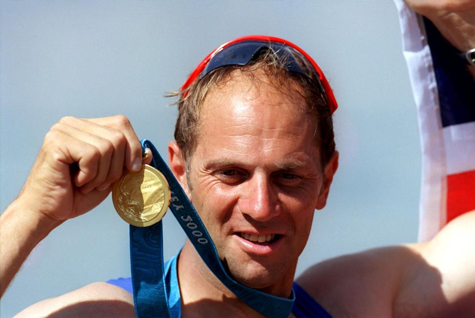 Great Britain's Steve Redgrave celebrates with his gold medal, the 5th he has won in his career