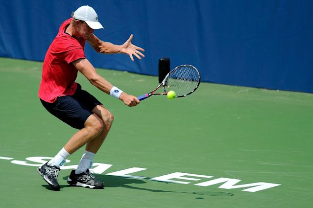 Kevin Anderson of South Africa returns a shot from Adrian Mannarino of France during the Winston-Salem Open at Wake Forest University on August 19, 2014 in Winston Salem, North Carolina (AFP Photo/Jared C. Tilton)