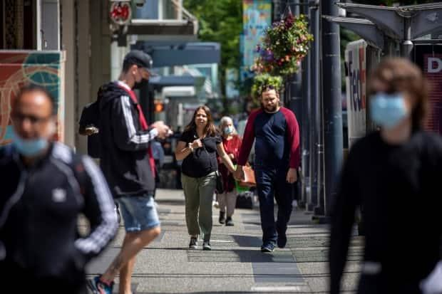 People are pictured walking along Granville Street in downtown Vancouver, British Columbia. (Ben Nelms/CBC - image credit)