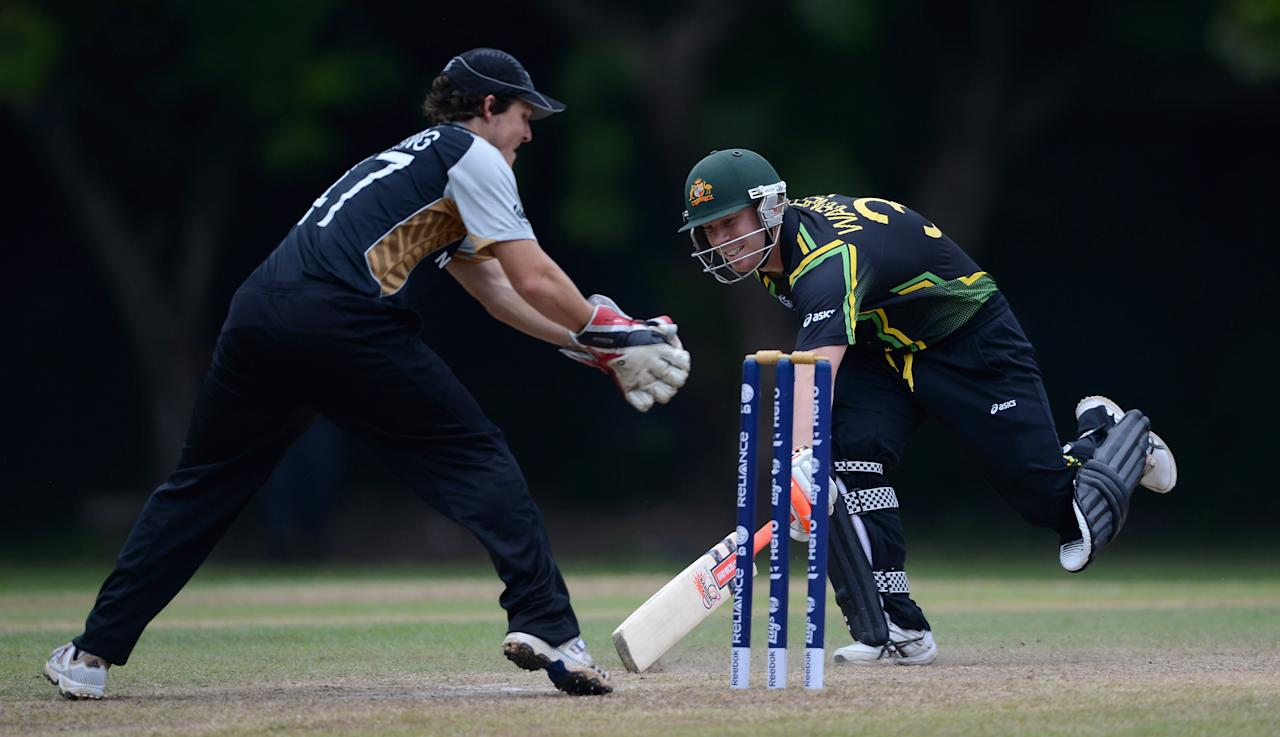 COLOMBO, SRI LANKA - SEPTEMBER 15:  David Warner of Australia makes his ground during the T20 World Cup Warm Up Match between Australia and New Zealand at Nondescripts Cricket Club on September 15, 2012 in Colombo, Sri Lanka.  (Photo by Gareth Copley/Getty Images,)