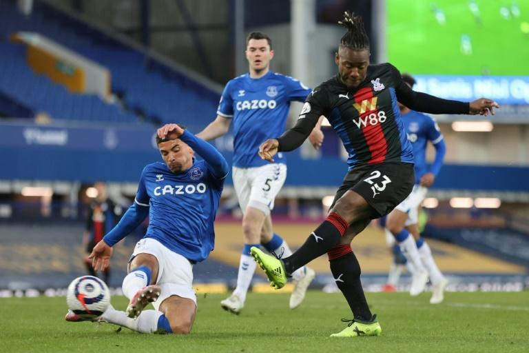 Bat man: Michy Batshuayi (right)dealt a blow to Everton's European hopes with a late equaliser for Crystal Palace