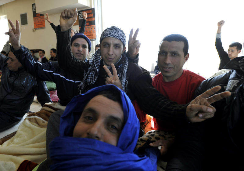 Immigrants make the V-sign during a hunger strike at the Labor Center of the northern Greek port city of Thessaloniki, Tuesday, Jan. 25, 2011. Immigrants, mostly from north Africa, about 50 in Thesssaloniki and more than 200 in Athens have begun a hunger strike, demanding to be legalized. (AP Photo/Nikolas Giakoumidis)