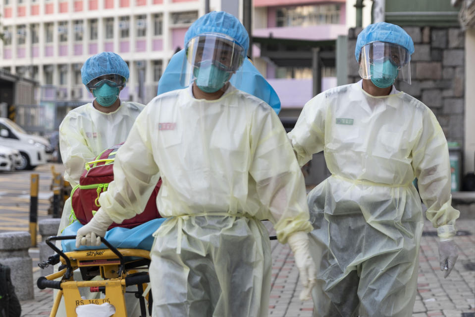 Medical staff wearing personal protective equipment (PPE) as a precautionary measure against the COVID-19 coronavirus approach Lei Muk Shue care home in Hong Kong on August 23, 2020. (Photo by May JAMES / May James / AFP) (Photo by MAY JAMES/May James/AFP via Getty Images)