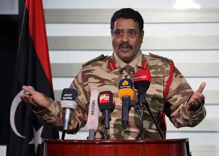 Spokesman of Libyan National Army (LNA) colonel Ahmed Al Masmary gestures during a news conference in Benghazi