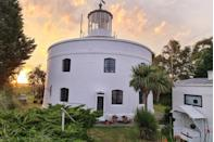 """<p>Rumour has it, it was from this very lighthouse that the first glimpse of WWII action was caught in Britain while <a href=""""http://www.westusklighthouse.co.uk/"""" rel=""""nofollow noopener"""" target=""""_blank"""" data-ylk=""""slk:West Usk"""" class=""""link rapid-noclick-resp"""">West Usk</a> was being used as a look-out post.</p><p>Being wider than it is tall, this lighthouse flaunts a different – if not quirky – layout and design. The Grade II-listed building is now over 190 years old and is filled with character, history and charm. After a day spent walking through the <a href=""""http://your.caerphilly.gov.uk/cwmcarnforest/content/welcome"""" rel=""""nofollow noopener"""" target=""""_blank"""" data-ylk=""""slk:Cwmcarn Forrest Drive"""" class=""""link rapid-noclick-resp"""">Cwmcarn Forrest Drive</a>, horse riding at the <a href=""""http://www.bhs.org.uk/enjoy-riding/find-a-place-to-ride/centres/stuv/springfield-riding-stables"""" rel=""""nofollow noopener"""" target=""""_blank"""" data-ylk=""""slk:Springfield Riding Stable"""" class=""""link rapid-noclick-resp"""">Springfield Riding Stable</a> or enjoying a round of golf at the world-famous <a href=""""http://www.celtic-manor.com/golf"""" rel=""""nofollow noopener"""" target=""""_blank"""" data-ylk=""""slk:Celtic Manor Resort"""" class=""""link rapid-noclick-resp"""">Celtic Manor Resort</a>, you can return to an entire menu of spa treatments and therapies or a dip in the rooftop hot tub. </p><p>The lighthouse and its surrounding land once belonged to the aristocratic family that lived in <a href=""""https://www.nationaltrust.org.uk/tredegar-house"""" rel=""""nofollow noopener"""" target=""""_blank"""" data-ylk=""""slk:Tredegar House"""" class=""""link rapid-noclick-resp"""">Tredegar House</a>, which is now part of the National Trust and makes for a pleasant dose of culture on your doorstep. Any admirer of Wordsworth will find it hard to resist the romantic pull of the nearby <a href=""""https://cadw.gov.wales/visit/places-to-visit/tintern-abbey"""" rel=""""nofollow noopener"""" target=""""_blank"""" data-ylk=""""slk:Tintern Abbey"""" class=""""link rapid-noclick-resp"""">Tintern Ab"""