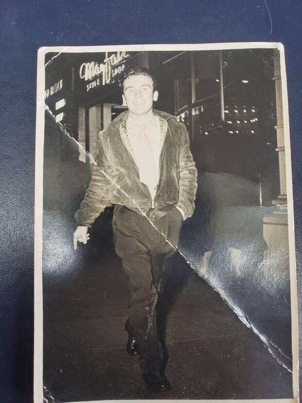 A young Jack Roche strolls down Granville Street in 1951.