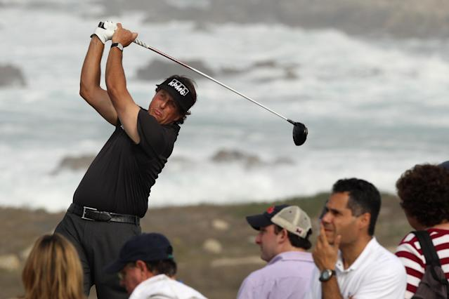 PEBBLE BEACH, CA - FEBRUARY 10: Phil Mickelson hits his tee shot on the 13th hole during the second round of the AT&T Pebble Beach National Pro-Am at the Monterey Peninsula Country Club (Shore Course) on February 10, 2012 in Pebble Beach, California. (Photo by Ezra Shaw/Getty Images)
