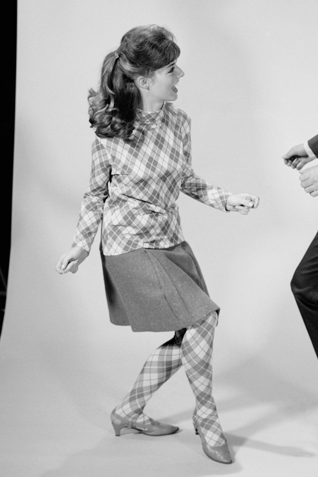 couple dancing the twist in the 1960s