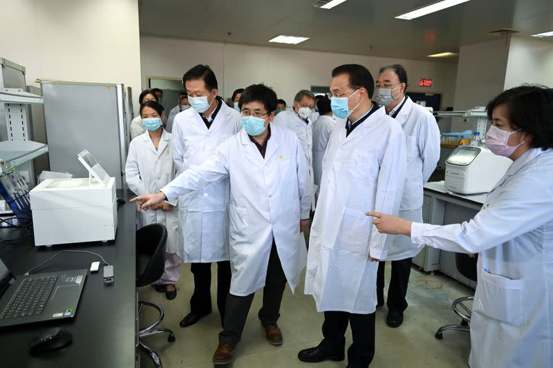 Chinese Premier Li Keqiang visits the Chinese Center for Disease Control and Prevention in Beijing