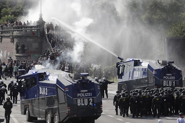 <p>Police use a water cannon to clear a road on the first day of the G-20 summit in Hamburg, northern Germany, Friday, July 7, 2017. (Photo: Matthias Schrader/AP) </p>