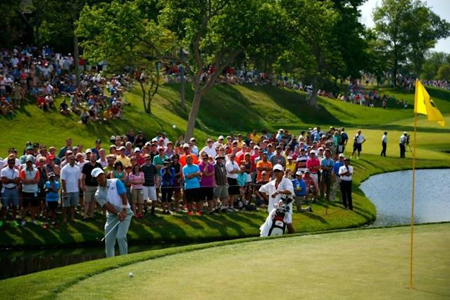 Fans line the course at last year's Memorial. Officials say spectators will be allowed back at this year's event following the coronavirus shutdown (AFP Photo/Matt SULLIVAN)