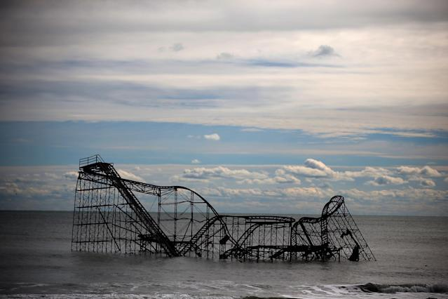 SEASIDE HEIGHTS, NJ - NOVEMBER 01: A roller coaster sits in the Atlantic Ocean after the Fun Town pier it sat on was destroyed by Superstorm Sandy on November 1, 2012 in Seaside Heights, New Jersey. With the death toll continuing to rise and millions of homes and businesses without power, the U.S. east coast is attempting to recover from the effects of floods, fires and power outages brought on by Superstorm Sandy. (Photo by Mark Wilson/Getty Images)