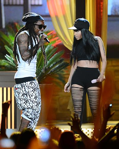 <p>Pulling up his pants is the least of Lil Wayne's fashion concerns here, but while we're at it, we might ask Nicki Minaj to do something about her pants too...</p>
