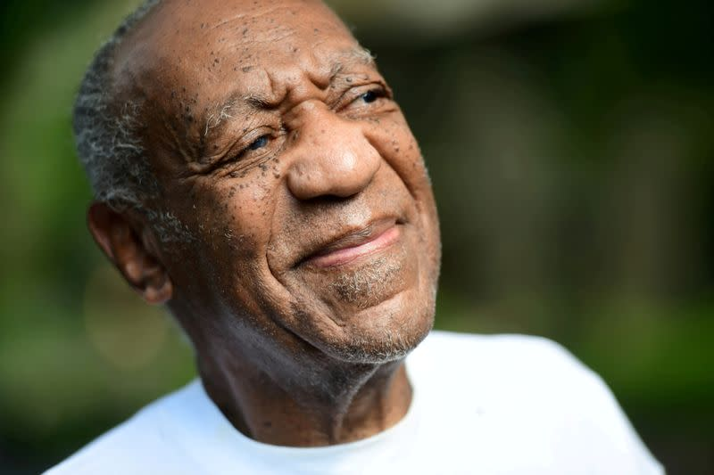 Bill Cosby looks on outside his house after Pennsylvania's highest court overturned his sexual assault conviction and ordered him released from prison immediately, in Elkins Park