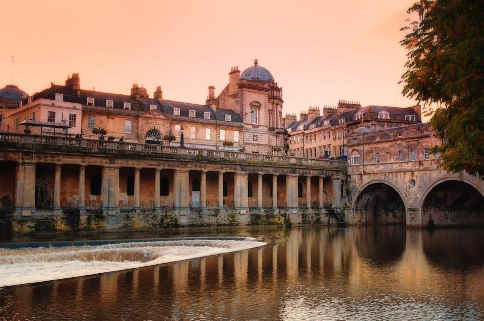"""<p>The biggest city in Somerset gets its name thanks to Roman-built baths, which are absolutely stunning. While you're there, also enjoy the Royal Crescent and Thermae Bath Spa, as well as lanes of independent shops and Bath abbey. <br></p><p><a class=""""link rapid-noclick-resp"""" href=""""https://go.redirectingat.com?id=127X1599956&url=https%3A%2F%2Fwww.booking.com%2Fsearchresults.en-gb.html%3Flabel%3Dgen173nr-1DCAEoggI46AdIM1gEaFCIAQGYAQm4AQfIAQzYAQPoAQGIAgGoAgO4As2olPoFwAIB0gIkNjMwYmNjMTUtZTFhYi00ZjBmLWIzNWQtYTJiMzM5ODEwMTJl2AIE4AIB%26lang%3Den-gb%26sid%3Dd557a040829a867b722f4b6cf8934591%26sb%3D1%26sb_lp%3D1%26src%3Dindex%26src_elem%3Dsb%26error_url%3Dhttps%253A%252F%252Fwww.booking.com%252Findex.en-gb.html%253Flabel%253Dgen173nr-1DCAEoggI46AdIM1gEaFCIAQGYAQm4AQfIAQzYAQPoAQGIAgGoAgO4As2olPoFwAIB0gIkNjMwYmNjMTUtZTFhYi00ZjBmLWIzNWQtYTJiMzM5ODEwMTJl2AIE4AIB%253Bsid%253Dd557a040829a867b722f4b6cf8934591%253Bsb_price_type%253Dtotal%2526%253B%26ss%3Dbath%26is_ski_area%3D0%26ssne%3DBiarritz%26ssne_untouched%3DBiarritz%26dest_id%3D-1412526%26dest_type%3Dcity%26group_adults%3D4%26group_children%3D0%26no_rooms%3D1%26from_sf%3D1&sref=https%3A%2F%2Fwww.cosmopolitan.com%2Fuk%2Fentertainment%2Ftravel%2Fg30397906%2Fbest-places-to-visit-uk%2F"""" rel=""""nofollow noopener"""" target=""""_blank"""" data-ylk=""""slk:BOOK NOW"""">BOOK NOW</a></p>"""