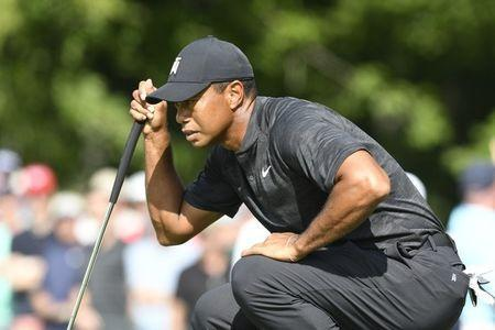Aug 31, 2018; Norton, MA, USA; Tiger Woods studies his putt on the 13th green during the first round of the Dell Technologies Championship golf tournament at TPC of Boston. Mandatory Credit: Mark Konezny-USA TODAY Sports