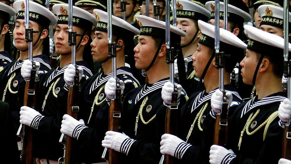 FILE PHOTO: An honour guard consisting of members of the Chinese navy stand in formation during a welcoming ceremony in the Great Hall of the People in Beijing November 23, 2011