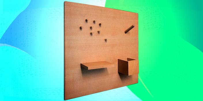 """<div class=""""caption""""> How will you use your bulletin board today? This guy comes with a magnetic peg, shelf, and pen cup, plus six box magnets, so you can rearrange it however and whenever you want. <a href=""""https://ilovehandles.com/shop/smorgas-2/"""" rel=""""nofollow noopener"""" target=""""_blank"""" data-ylk=""""slk:SHOP NOW"""" class=""""link rapid-noclick-resp"""">SHOP NOW</a>: Smorgas Utility Board by ILOVEHANDLES, $75, ilovehandles.com </div> <cite class=""""credit"""">Photo courtesy of West Elm</cite>"""