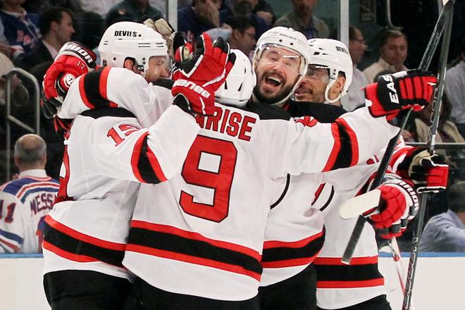 NEW YORK, NY - MAY 23:  Zach Parise #9, Travis Zajac #19, Ilya Kovalchuk #17 and Bryce Salvador #24 of the New Jersey Devils celebrate their 5 to3 win over the New York Rangers in Game Five of the Eastern Conference Final during the 2012 NHL Stanley Cup Playoffs at Madison Square Garden on May 23, 2012 in New York City.  (Photo by Bruce Bennett/Getty Images)