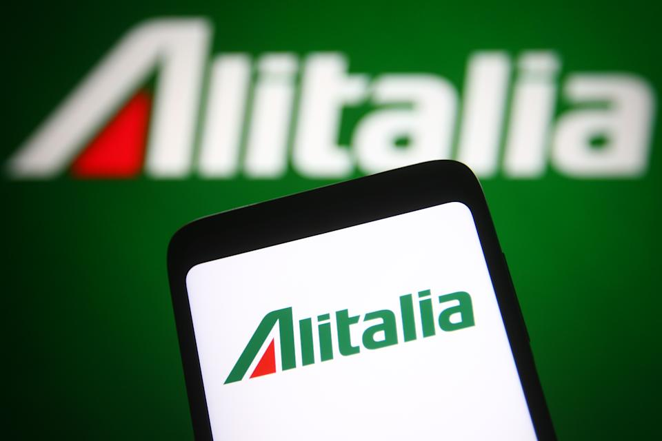 UKRAINE - 2021/06/06: In this photo illustration, an Alitalia logo is seen on a smartphone and a pc screen in the background. (Photo Illustration by Pavlo Gonchar/SOPA Images/LightRocket via Getty Images)