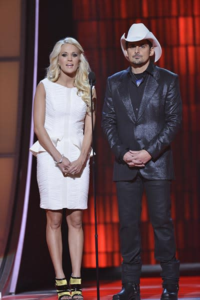 Carrie Underwood in white peplum -- Ahh, the ubiquitous peplum silhouette. In textured white with black and gold booties, it sure makes an impact.