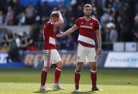 Middlesbrough's Ben Gibson and Adam Clayton look dejected after the match