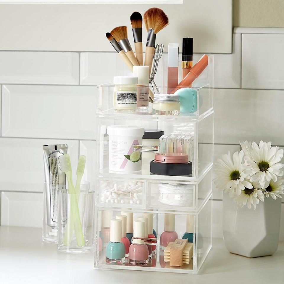 """<p>Clean up your counters with this <a href=""""https://www.popsugar.com/buy/Luxe-Acrylic-Tall-Makeup-Storage-Kit-476417?p_name=Luxe%20Acrylic%20Tall%20Makeup%20Storage%20Kit&retailer=containerstore.com&pid=476417&price=57&evar1=casa%3Auk&evar9=46463978&evar98=https%3A%2F%2Fwww.popsugar.com%2Fhome%2Fphoto-gallery%2F46463978%2Fimage%2F46464021%2FLuxe-Acrylic-Tall-Makeup-Storage-Kit&list1=shopping%2Corganizing%2Corganization%2Cbathrooms%2Chome%20organization%2Chome%20shopping&prop13=api&pdata=1"""" rel=""""nofollow"""" data-shoppable-link=""""1"""" target=""""_blank"""" class=""""ga-track"""" data-ga-category=""""Related"""" data-ga-label=""""https://www.containerstore.com/s/bath/makeup-organizers/luxe-acrylic-tall-makeup-storage-starter-kit/12d?productId=11009074"""" data-ga-action=""""In-Line Links"""">Luxe Acrylic Tall Makeup Storage Kit</a> ($57).</p>"""