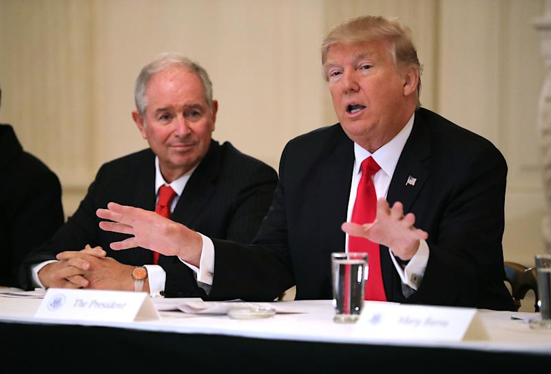 WASHINGTON, DC - FEBRUARY 03: U.S. President Donald Trump (R) delivers opening remarks at the beginning of a policy forum with business leaders chaired by Blackstone Group CEO Stephen Schwarzman in the State Dining Room at the White House February 3, 2017 in Washington, DC. Leaders from the automotive and manufacturing industries, the financial and retail services and other powerful global businesses were invited to the meeting with Trump, his advisors and family. (Photo by Chip Somodevilla/Getty Images)