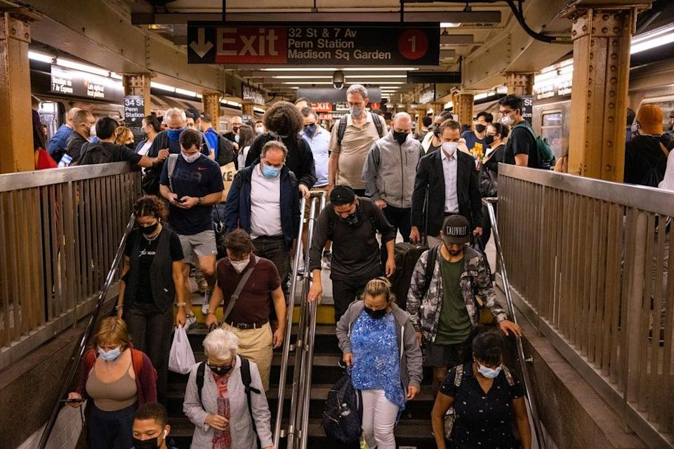 Commuters deal with delays caused by heavy rainfall and flooding in the New York City subway during the morning rush after the remnants of Tropical Storm Ida brought drenching rain and the threat of flash floods to parts of the northern mid-Atlantic, in New York City (REUTERS)