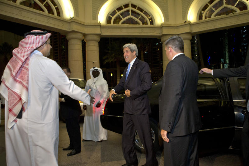 U.S. Secretary of State John Kerry, center, greets Qatari Prime Minister and Foreign Minister Hamad bin Jassim Al Thani for their dinner meeting in Doha, Qatar, on Saturday, June 22, 2013. Kerry began an overseas trip plunging into two thorny foreign policy problems facing the Obama administration: unrelenting bloodshed in Syria and efforts to talk to the Taliban and find a political resolution to the war in Afghanistan. (AP Photo/Jacquelyn Martin, Pool)