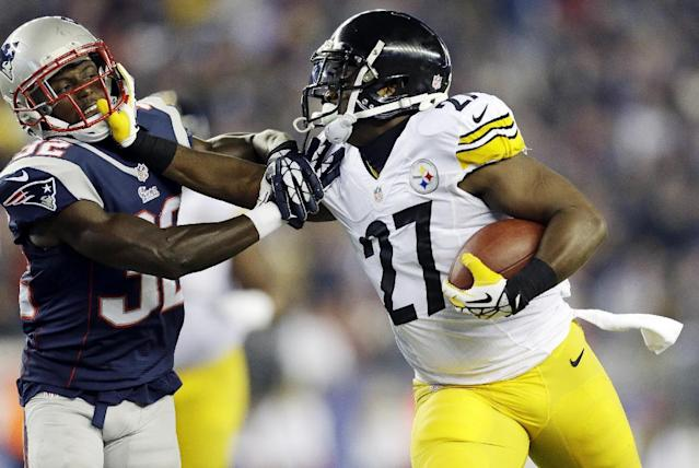 Pittsburgh Steelers running back Jonathan Dwyer (27) stiff-arms New England Patriots free safety Devin McCourty during a run in the second quarter of an NFL football game Sunday, Nov. 3, 2013, in Foxborough, Mass. (AP Photo/Steven Senne)