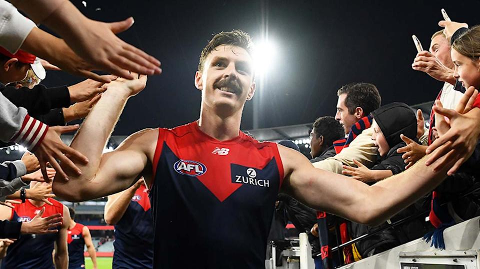 Jake Lever (pictured) high fives fans after winning a match.