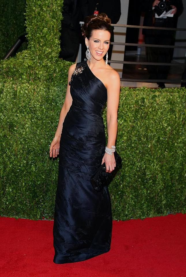"Kate Beckinsale brought some much-needed glamour to the party circuit in a brooch-adorned asymmetrical J. Mendel black ball gown and diamond cuff. Angela Weiss/<a href=""http://www.wireimage.com"" target=""new"">WireImage.com</a> - February 22, 2009"